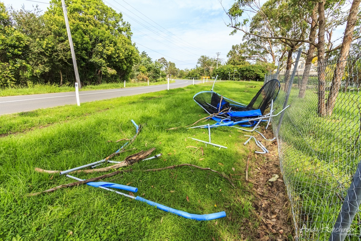 This trampoline was plucked out of a garden 500m away and dumped in pieces near the edge of the village. Fortunately the tornado struck at night, this road is very close to a large senior school.